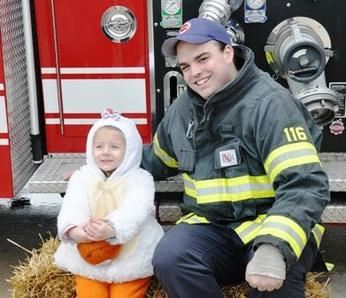 Fire Fighter Sitting with a Child
