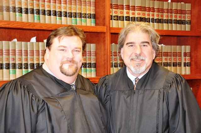 Two judges in front of a bookcase